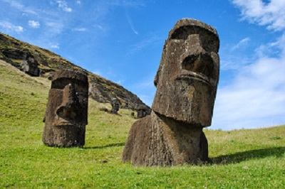 Easter Island heads on green hillside